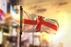 England Flag Against City Blurred Background At Sunrise Backligh Royalty Free Stock Image