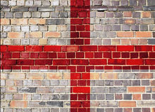 England flag on a brick wall background Stock Images