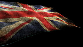 Waving British Union Jack flag. Grunge British Union Jack flag waving against black stock footage