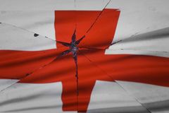 England flag is reflected in broken mirror. Still life stock image