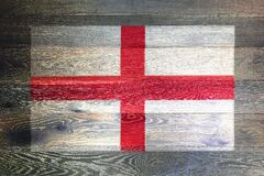 England flag on rustic old wood surface background