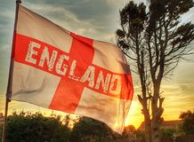 England flag. At sunset 2018 World Cup isle of Wight South Wight tree sun going down summer evening Russia stock image