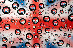 England flag. In waterdroplet reflection Royalty Free Stock Images