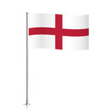 England flag waving on a metallic pole. Royalty Free Stock Images
