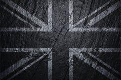England flagga p? den textural svarta grova stenen royaltyfri foto
