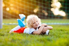 England football fan kids. Children play soccer royalty free stock photography
