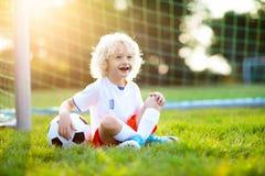 England football fan kids. Children play soccer stock photos