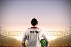 England football player holding ball Royalty Free Stock Image