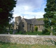 Country church. England, Gloucestershire, Cotswolds, the small rural country church and churchyard at Icomb royalty free stock image