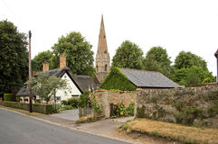 England Houghton Mill Church. England Houghton Mill : typical old house with medieval church in the background Royalty Free Stock Photo