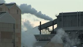 Industrial chimney pumping out lots of pollution. England and industrial landscape with smoking chimney stock video
