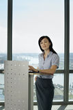 England, London, Canary Wharf, businesswoman standing behind lectern, giving presentation Stock Image
