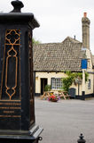 England Old Market Square. The market square of Houghton Mill in England. There is a pub in the background with tables Royalty Free Stock Image