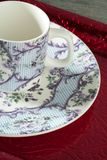 England old style tea cup and dish over red tray Stock Photos