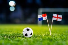 England - Panama, Group G, Sunday, 24. June, Football, World Cup, Russia 2018, National Flags on green grass, white football ball. On ground royalty free stock photo