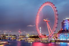 England, the United Kingdom: London Eye, a giant Ferris wheel on bank of River Thames. At night royalty free stock image