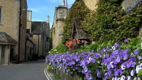 England village in Cotswolds holiday area pub and street 4K stock footage