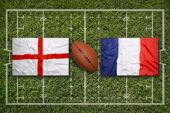 England vs. France flags on rugby field Stock Photos