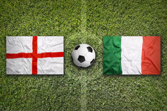 England vs. Italy flags on soccer field Royalty Free Stock Images