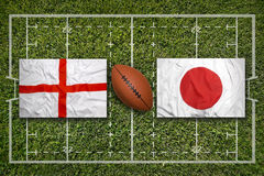 England vs. Japan flags on rugby field Stock Image