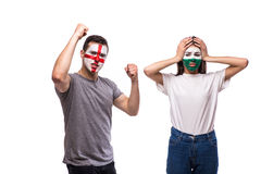 England vs Wales. Football fans of national teams demonstrate emotions: Wales lose, England win. European football fans concept Stock Photos