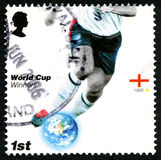 England World Cup Winners UK Postage Stamp. UNITED KINGDOM - CIRCA 2006: A used postage stamp from the UK, issued to commemorate past Football World Cup Winners Royalty Free Stock Image