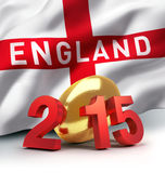 England 2015. 2015 year illustrated with a golden rugby ball, a waving English flag behind Royalty Free Stock Photography