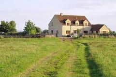 Englisches Bauernhaus und Boden Lizenzfreies Stockbild