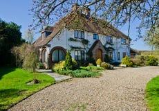 Englisches Dorf-Häuschen Stockbilder