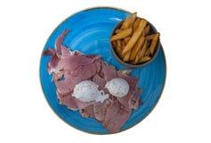 Englisches Frühstück mit Schinken, Spiegelei und Pommes-Frites stockfoto