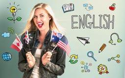 Englisches Thema mit der jungen Frau, die Flaggen hält stockfotografie