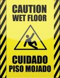 Englisches und spanisches nasses Fußbodenzeichen Stockfotos