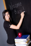 Classroom Blackboard Books Apple English 101. A teacher welcomes her students back to the classroom Royalty Free Stock Images