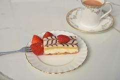 Fresh cream slice cake with strawberries and tea Royalty Free Stock Image
