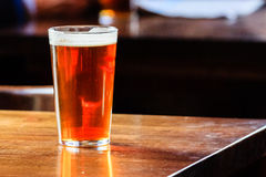 English ale on a table. An english ale on a wooden table in a pub in London, UK Royalty Free Stock Image