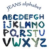The English alphabet is laid out from letters consisting of jeans clothes of various shade. Isolated  English alphabet is laid out from letters consisting of Stock Photos