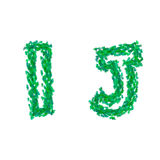 English alphabet made with green leaves, summer theme, letters I J Royalty Free Stock Photo