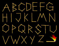 English alphabet made from matches. Royalty Free Stock Image