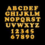 Gold alphabet foil party celebration balloons. black background. English alphabet and numerals from yellow Gold balloons on a black background. holidays and Royalty Free Stock Photography
