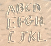 English alphabet on sand Royalty Free Stock Images