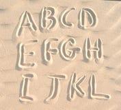 English alphabet on sand Royalty Free Stock Images