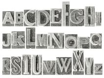 Alphabet set in mixed metal type. English alphabet set - a collage of 26 isolated letters in letterpress metal type printing blocks, a variety of mixed fonts stock photos