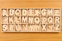 English alphabet set in wooden box Stock Image