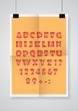 English alphabet.  Twice a folded orange poster with clamps. Royalty Free Stock Photo