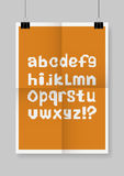 English alphabet.  Twice a folded orange poster with clamps. Royalty Free Stock Photos