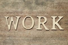 English alphabet in word work place on wood background royalty free stock photos