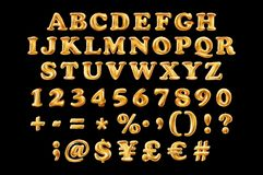 English alphabetic fonts and numbers from yellow Golden font balloons on a black background. holidays and education Stock Image