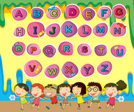 English alphabets with children background Royalty Free Stock Photo