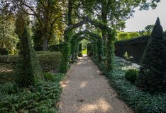 English arcade in the picturesque Jardins du Manoir d Eyrignac in Dordogne. France stock photo