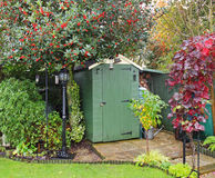English Back Garden With Shed And Lamp Royalty Free Stock Photos